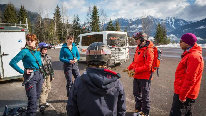 Safety briefing before a day of Kootenays heliskiing.