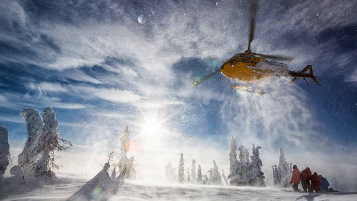 Flight to the first heliskiing run in the Kootenays.