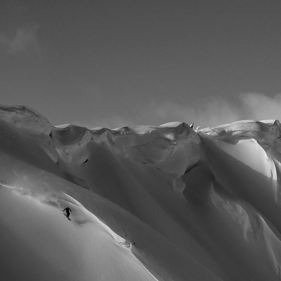 skier carving fresh lines with stellar heli ski