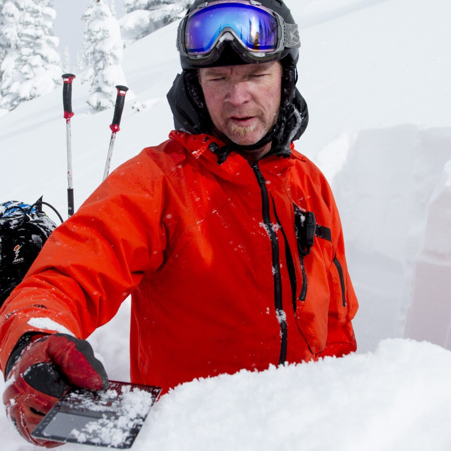 stellar heliski guide checks snow conditions