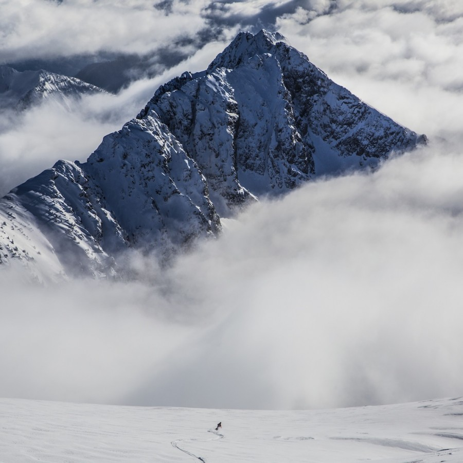 skiier in high alpine bowl kootenays bc
